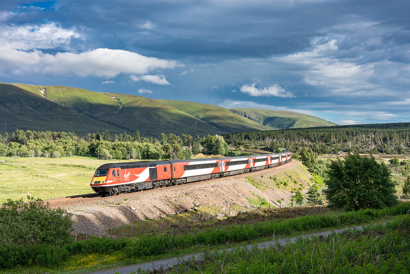 220618,   On the penultimate run under the Virgin East coast franchise,43251 rounds the curve at Dalwhinnie with the  1S16  12:00 London Kings Cross-Inverness