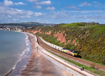 030518 70804  heads along the sea wall with the 09:45  6B36 ThO-Q 08:16 Moorswater-Aberthaw cement works