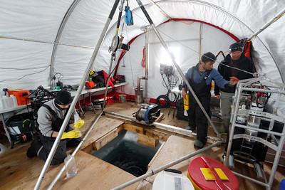 Inside the tent of the Ice Camp - Setting up the UVP (Atshushi, José and Eric)