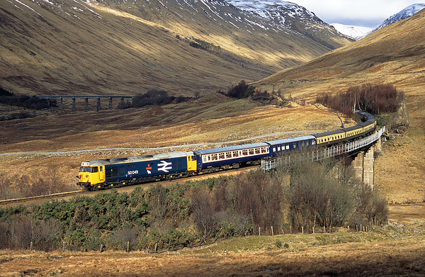 Perfect timing, this was the only time the sun lit the scene whilst we were there, result!! 50049 rounds the Horseshoe Curve on 1Z24 10:24 Fort William-Dalmuir 06/03/05