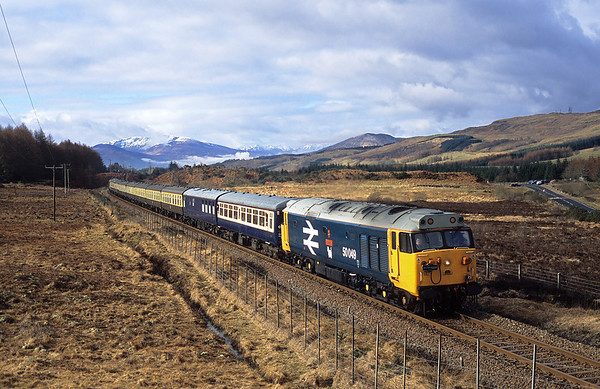 Just as the sun breaks through the clouds 50049 passes Achnabobane on 1Z24 10:24 Fort William-Dalmuir 06/03/05