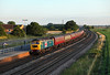 As the summer light fades 47580 passes Ulleskelf station on 1T39 17:00 Scarborough - York, 22/07/14