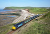 With St Bees head in the background 37419 heads south on 2C40 08:42 Carlisle - Barrow in Furness, 10/06/15<br /> **Taken using a pole