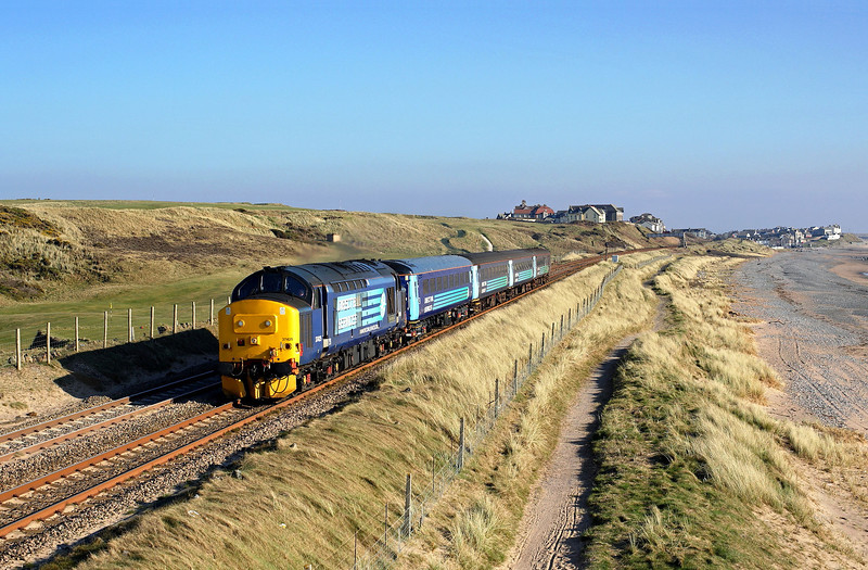 One of my favorite shots on the line.<br /> 37425 heads away from Seascale past the golf links on 2C41 14:37 Barrow in Furness - Carlisle, 17/03/16<br /> **Taken with a pole