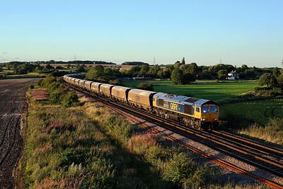 66763 passes Burton Lane on 6H55 16:37 Tyne Dock - Drax PS, 15/08/17 *Taken using a pole