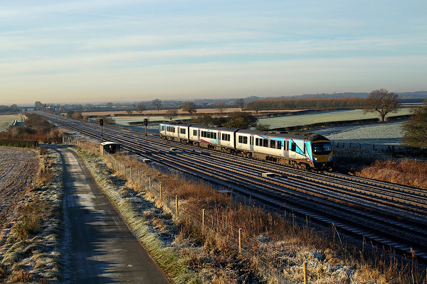 In the early morning frost 185135 passes Brumber on 1E81 07:15 Liverpool LS - Scarborough, 12/12/17 *Taken using a pole