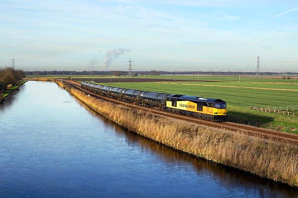 60021 nears Godnow Bridge on 6E32 08:55 Colas Ribble Rail - Lindsey empty tanks, 18/12/17 *Taken using a pole
