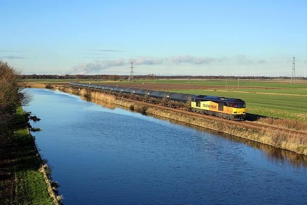 60096 runs along the canal towards Godnow Bridge on 6E32 08:55 Colas Ribble Rail - Lindsey, 04/12/17 *Taken using a pole