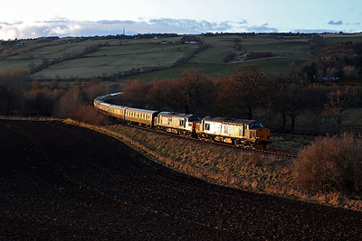 37605 + 37259 glint in the sun passing Fodderty on 1Z38 17:20 Kyle of Lochalsh - Inverness 'Easter Highlander' 01/04/18