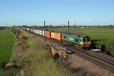 66532 crosses Temple Hirst junction on 4L79 16:12 Tees Dock - Felixstowe liner, 20/04/18 *Taken using a pole