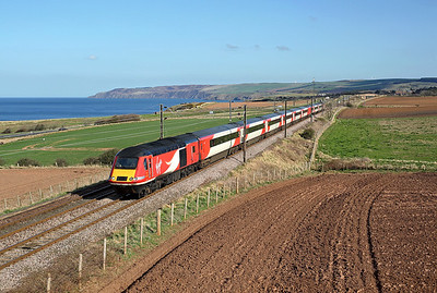With St Abbs head sticking out into the North sea, 43312 passes Innerwick on 1S16 12:00 LKX - Inverness, 19/04/18 *Taken using a pole