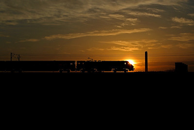 An unidentified 91 is silhouetted against the setting sun passing Heck Ings on 1E24 17:00 Edinburgh - LKX, 18/04/18