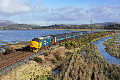 37403 runs along the Duddon estuary past Lady Hall on 2C49 11:38 Barrow in Furness - Carlisle, 01/02/18 *Taken using a pole