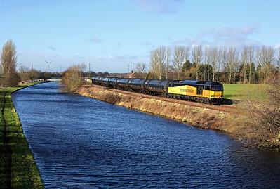 60085 runs alongside the canal past Godnow Bridge on 6E32 08:55 Preston Docks - Lindsey empty tanks, 17/01/18 *Taken using a pole