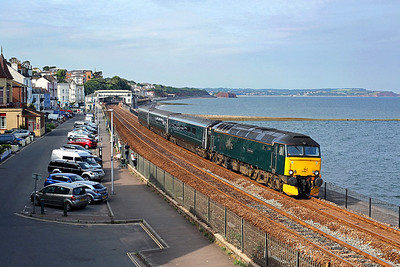 57605 catches the late evening sun as it pulls away from Dawlish on 2C51 17:51 Exeter St Davids - Penzance, 23/06/18 *Taken using a pole