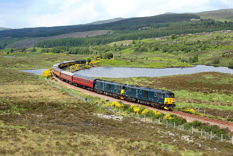 73969 + 73968 run along the edge of Loch a'Chuilinn on the rear of 1Z73 05:00 Paisley - Kyle of Lochalsh 'SRPS charter' 09/06/18<br /> *Taken using a pole