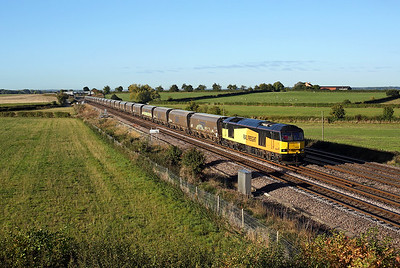60056 passes Colton junction in the early morning sunshine on 6N45 07:30 Drax PS - Tyne Dock empty biomass, 01/10/18