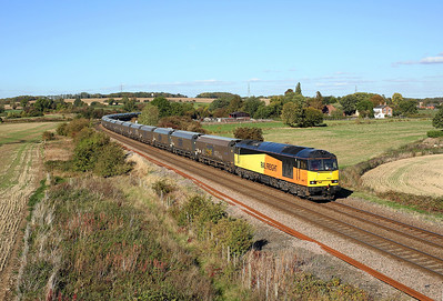 60047 passes Burton Lane on 6H70 12:24 Tyne Dock - Drax PS biomass, 28/09/18 *Taken using a pole