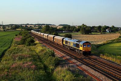 66755 passes Burton Lane on 6H55 16:49 Tyne Dock - Drax PS biomass, 23/07/19 *Taken using a pole