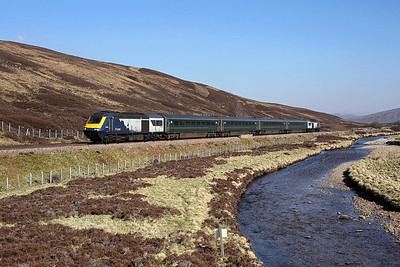Scotrail '7 cities' liveried 43125 leads a 'classic' rake of stock in GWR green towards Drumochter on 1B52 09:44 Inverness - Edinburgh, 22/04/19 *Taken using a pole