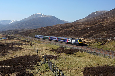 Scotrail '7 cities' liveried 43149 heads down from Drumochter summit with a mixed rake of classic stock on 1H07 08:33 Edinburgh - Inverness, 22/04/19 *Taken using a pole