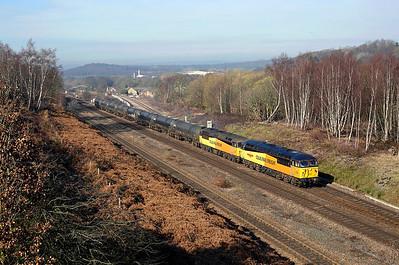 56049 + 56078 pass Heaton Lodge junction on 6E32 10:02 Colas Ribble Rail - Lindsey empty tanks, 25/02/19