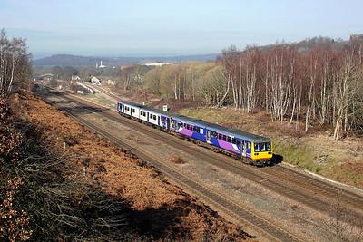 142090 + 150207 pass Heaton Lodge junction on 1J06 09:24 Southport - Leeds, 25/02/19
