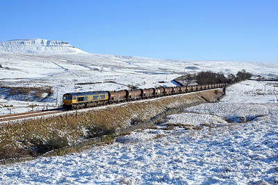 With Pen-y-gent dominating the snowy landscape 66740 nears Selside on 6S94 04:28 Wembley - Irvine 'china clay' 23/01/19