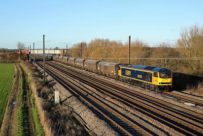 60095 passes Raskelf on 6H70 12:19 Tyne Dock - Drax PS biomass, 01/01/19 *Taken using a pole