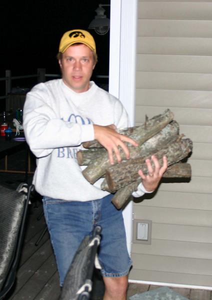 Todd bringing more firewood.  ( 2004 )