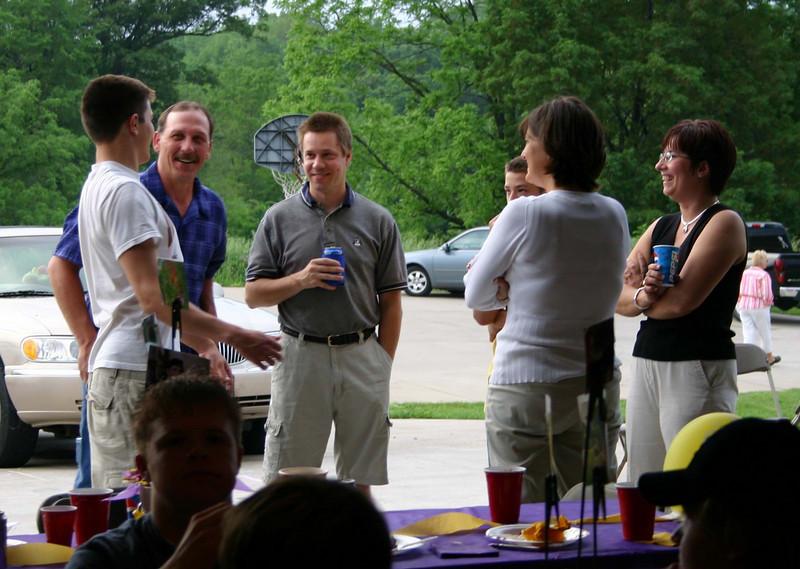 Cory, Todd, Alex and Lori talking at Shane's graduation party at the Brooke house.  ( 2004 )