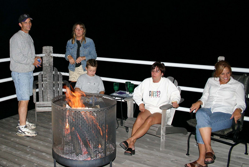 Phil, Mary, Bryce, Lori and Patti by the fire.  ( 2004 )