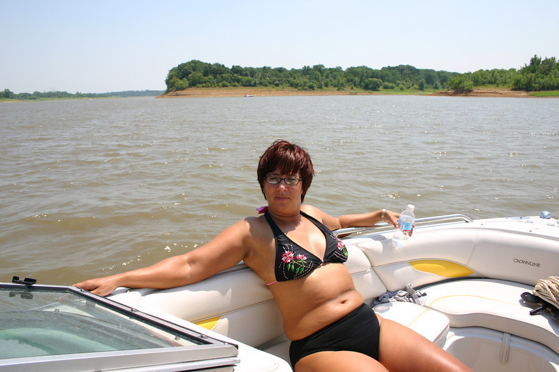 Lori catching some rays in the boat.  ( 2005 )