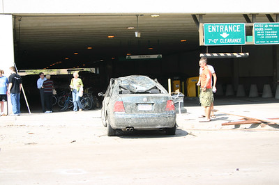 Damaged car outside the parking ramp, downtown Iowa city  ( 2006 )