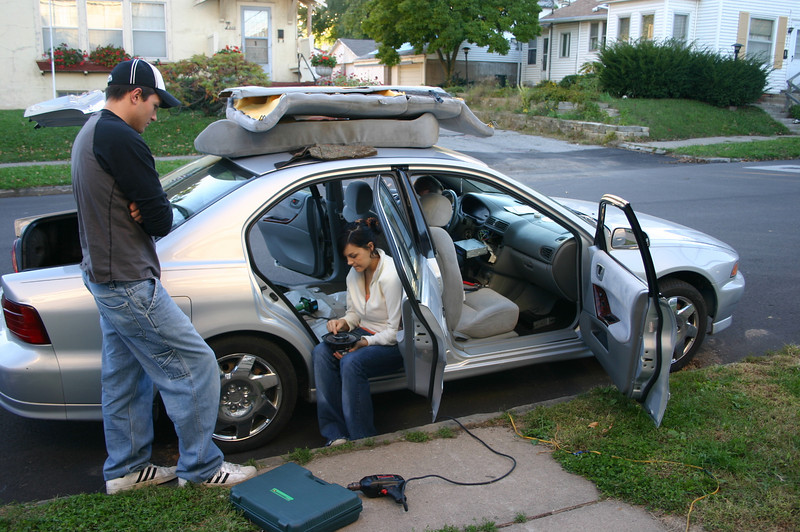 Cory, Erin and Alex installing a stereo in Cory's car  ( 2007 )