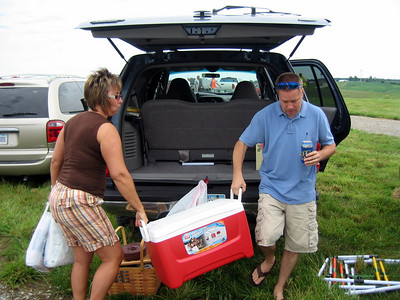 Todd and Lori unloading the food and beverages for tailgating ( 2010 )