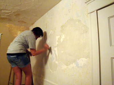 Erin scraping the plaster ( 2010 )