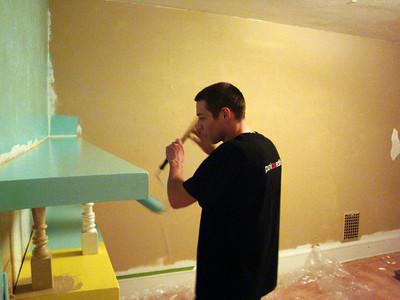 Alex painting the bookshelf in his bedroom ( 2010 )