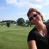 Lori playing golf in Dewitt ( 2011 )