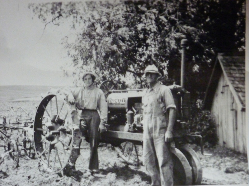 Great Aunt and Great Grandfather - This is Deb's Great Aunt Margie, and her Great-Grandpa. Taken sometime in the late 1930's or early 1940's. The tractor is a 1935 Farmall F-12.
