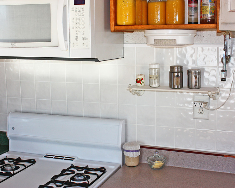 Finshed Wallboard - Galen finished putting the wallboard on the wall of my kitchen last night...just have a couple other small things to do before it's totally finished, but it's close enough I could reclaim my kitchen today!!!  I got it cleaned up and had to get a photo to show the new cleaner wall, although think I need to try again, cause this one is a little on the dark side, but it will do for now.  :)