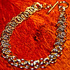 Chain maille bracelet - The first chain maille I've ever done.  I made a bracelet.  I don't think the jump rings I found were really all that great, but they worked for my first time making something.  Sadly my eyes won't let me do lots of it, cause I'm getting old and think I need bifocals.  LOL  I do love chain maille thought...especially bracelets.  :-))