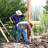"Setting posts for Galen's ""Shop"" - Galen is finally getting a work shop built here on our new farm.  He has gone almost a year with having most of his tools packed up in the horse trailer, and having to work out of the barn, or a small lean to shed, or just outside in the weather when he works on his projects.  It's good to see his building take shape.  :-))"