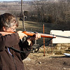 Target Practicing - While it's not something I've done to much of in the last 20 years, I do still know what I'm doing with a gun!  We went over to my parents house yesterday, and had a little fun hitting a swinging chicken my beloved Uncle made for target practicing.  It's nice to know I can STILL hit what I'm aiming at, after all these years.