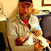 Proud Uncle - Galen holding Kainsley for the first time!