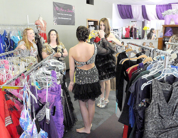 F. BRIAN FERGUSON/THE REGISTER-HERALD=Arear teens try on prom dresses during Saturday's Grand Opening of Fit for a Queen.