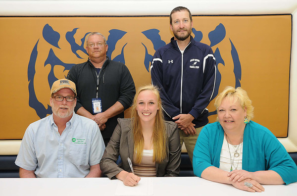 Kaylee Dickenson, of Shady Spring High School, center, signed to play volleyball and track at Glenville State College. Seated with Kaylee, from left, William Dickerson, father, left, and Patricia Dickerson, mother. Standing from left, Mike Evans and Vince Culicerto, track coaches.<br /> Rick Barbero/The Register-Herald