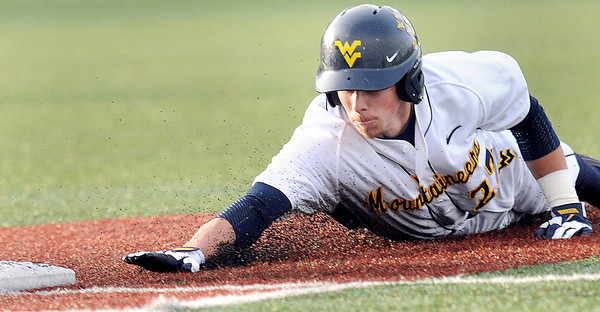 F. BRIAN FERGUSON/THE REGISTER-HERALD=The WVU Mountaineer Brady Wilson dives safely back to first against Kansas on Friday evening.