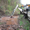 Division of Highways crew clean out a culvert off Route 20 in Hinton Monday afternoon that got backed up from heavy rain that occured last week in the area.<br /> Rick Barbero/The Register-Herald