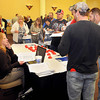 F. BRIAN FERGUSON/THE REGISTER-HERALD=Stacey Brown, left, with United Coal talks with applicants during the Register-Herald Spring Job Fair on Wednesday at Tamarack.
